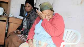 Harriette Manyathela, the mother of Luvuyo Manyathela, mourns after her son was stabbed to death. Picture: Henk Kruger/African News Agency (ANA)