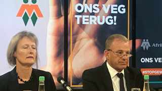 Head of AfriForum's private prosecuting unit, Advocate Gerrie Nel, with Monique van Oosterhout, who is seeking a private prosecution against her husband Alexis Bizos. Alexis is son of world-renowned human rights advocate George Bizos. Picture: Jonisayi Maromo
