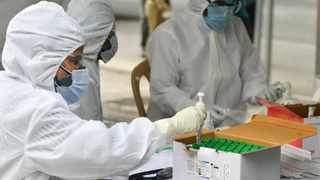 Health workers wearing personal protective equipment (PPE) suits. File picture: IANS