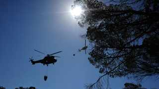 Helicopters collecting water from the Molteno reservoir in Oranjezicht yesterday. Picture: Henk Kruger / African News Agency (ANA)