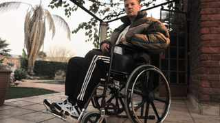 Hendrik Grobler sits in his wheelchair which he has been confined to as he recovers from injuries sustained from Moot police station members. Picture: Sizwe Ndingane