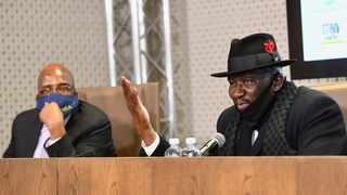Home Affairs Minister Aaron Motsoaledi and Police Minister Bheki Cele attend a Justice Cluster media briefing in Pretoria. Picture: Jairus Mmutle/GCIS