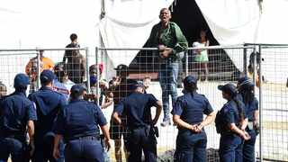 Homeless people at the Strandfontein shout at law enforcement officers. Some of them are frustrated being in a lockdown area and claim they are forced to be there and want to leave. Picture: Phando Jikelo/African News Agency (ANA)