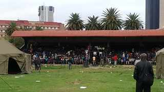 Homeless people sit in the main stand at the Caledonian Stadium. Picture: Goitsemang Tlhabye