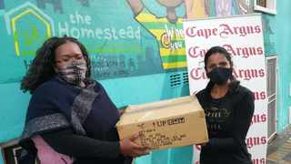 Homestead Project director Nqabakazi Mathe and Independent Media's marketing coordinator Rehana Rutti with some of the books donated by Jan Van Riebeeck Primary School.