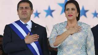 Honduran President Juan Orlando Hernandez, left, stands with his wife Ana Garcia, during the presidential inauguration ceremony for his second term. Picture: Fernando Antonio/AP