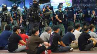 Hong Kong police detain protesters against the new security law during a march marking the anniversary of the Hong Kong handover from Britain to China. Picture: Vincent Yu/AP