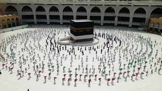 Hundreds of Muslim pilgrims circumambulate around the Kaaba, the cubic building at the Grand Mosque, as they keep social destination to protect themselves against coronavirus. FIle Picture: AP Photo