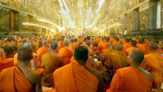 Hundreds of Thai Buddhist Monks pray for the health of Thailand's King inside the Temple of the Emerald Buddha at the Grand Palace in Bangkok. Picture: Reuters