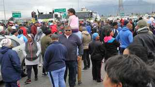 Hundreds of residents took to the streets on Tuesday and brought parts of the Cape Flats to a standstill in protesting against their deteriorating socio-economic conditions. The march was organised by Western Cape Total Shutdown Communities. Photo: Henk Kruger / African News Agency (ANA)