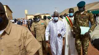 In this file photo taken on March 20, 2021, Malian Prime Minister Moctar Ouane and his delegation attend the inauguration of the new river port of Konna in central Mali. Mali's transitional President Bah Ndaw and Malian Prime Minister Moctar Ouane have resigned after the military arrested them on May 24. Photo by Michelle Cattani/AFP