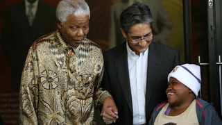 In this file picture, Mpho Mathibela meets with former president Nelson Mandela and Achmat Dangor, CEO of the Nelson Mandela Foundation in 2007. It had always been her wish to meet Mandela. Picture: Werner Beukes/SAPA