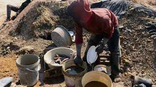 In this file picture, illegal miners sieve gold from the soil dug from the closed shafts using water and self made sieves. Picture: Boxer Ngwenya/African News Agency(ANA)