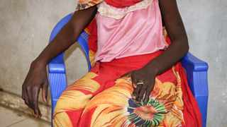 In this photo taken Friday, Dec. 7, 2018, an 18-year-old woman recounts the day in early November when she and a friend were bound, dragged into the bush and raped by four men with guns, as she sits in a hospital in Nhialdu, South Sudan. (AP Photo/Sam Mednick)