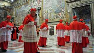 In this photograph released by the Vatican newspaper L'Osservatore Romano, cardinals enter the Sistine Chapel prior to the start of the conclave, at the Vatican on Tuesday.