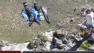 In this sreen grab from You Tube, Jeb Corliss, wearing a black suit, and cameraman flyer Jeff Nebelkopf in blue, leap from Table Mountain yesterday. Too view the footage, go to www.youtube.com