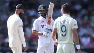 India's Virat Kohli and England's James Anderson during a review. Photo: Carl Recine/Reuters
