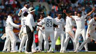 India's Virat Kohli and teammates celebrate after winning the test match against England at the Oval on Monday. Photo: Andrew Couldridge/Reuters