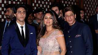Indian Bollywood actor Shah Rukh Khan (R) poses for a picture with his wife Gauri Khan and son Aryan Khan. Picture: Sujit Jaiswal/AFP