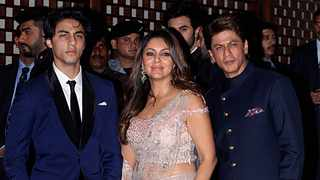 Indian Bollywood actor Shah Rukh Khan (R) poses for a picture with his wife Gauri Khan and son Aryan Khan as they attend the pre-engagement party of India's richest man and Reliance Industries Limited Chairman, Mukesh Ambani's eldest son Akash Ambani and fiancee Shloka Mehta, in Mumbai on June 30, 2018. Picture: Sujit Jaiswal / AFP