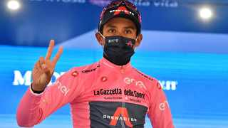 Ineos Grenadiers rider Egan Arley Bernal Gomez of Colombia celebrates wearing the maglia rosa on the podium after stage 16. Photo: Jennifer Lorenzini/Reuters