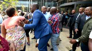 Informal traders affiliated to Tshwane Barekisi Forum are forced out of Tshwane House by Metro Police VIP protection officers. They had gone to the municipal headquarters to demand payment of bursary funds. Picture: Bongani Shilubane/ANA
