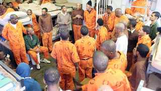 Inmates at Pollsmoor Maximum Security Prison in Cape Town show members of the media gang signs as they walk through the prison during an inspection by the Judicial Inspectorate for Correctional Services in 2016. Bertram Malgas