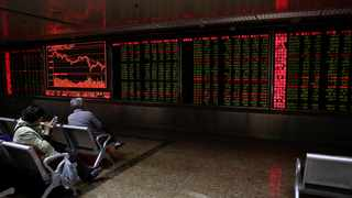 Investors monitor stock prices at a brokerage house in Beijing, Tuesday, April 3, 2018. Asian stocks fell for a second day Tuesday amid jitters about U.S.-Chinese trade tensions and mounting public scrutiny of technology companies. (AP Photo/Andy Wong)