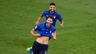 Italy's midfielder Manuel Locatelli (front) celebrates with Italy's forward Lorenzo Insigne after he scored the team's first goal during the Euro 2020 match against Switzerland. Photo: Riccardo Antimiani/AFP