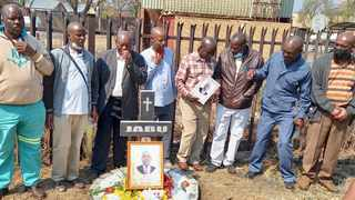 Jabu Boloi's family, friends and other taxi operators erected a cross and laid a wreath to remember his legacy after he was shot and killed in 2019 by a suspected drug dealer. Picture: James Mahlokwane
