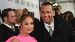 """Jennifer Lopez, left, and Alex Rodriguez attend the world premiere of """"Second Act"""" at Regal Union Square Stadium 14 on Wednesday, Dec. 12, 2018, in New York. (Photo by Evan Agostini/Invision/AP)"""