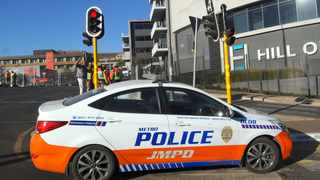 Joburg Metro police officers rescued a Taxify driver from the boot of his car after he was hijacked by suspects who stripped his vehicle. Picture: Karen Sandison/African News Agency (ANA)
