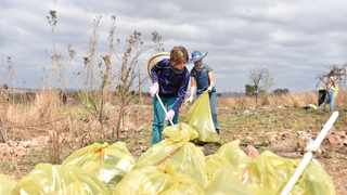 Jocelyn Kirwaa and Ezabella Kruger helping Erasmia residents on a clean-up campaign on World Cleanup Day. Picture: Thobile Mathonsi/African News Agency (ANA)