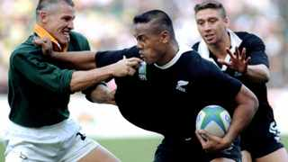 Jonah Lomu tries to hold off James Small in the 1995 Rugby World Cup final at Ellis Park. Picture: Mark Baker, Reuters