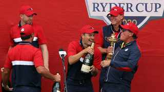 Jordan Spieth of team United States, captain Steve Stricker of team United States, and vice-captain Phil Mickelson celebrate with champagne after Team United States defeated Team Europe. Photo: Richard Heathcote/Getty Images via AFP