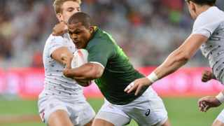 Juan de Jongh of South Africa breaks through English defence to score during the 2015 Cape Town Sevens at Cape Town Stadium, South Africa on 12 December 2015 ©Gavin Barker/BackpagePix