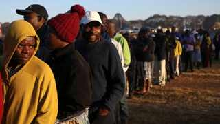 Just more than 10 000 polling booths opened Monday around Zimbabwe where voting for a new president began at 7 am. Picture: Reuters/Siphiwe Sibeko