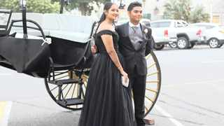 KIARA Maharaj and Shivash Mahaveer arrive in a horse-drawn carriage for the Westville Girls' High School Matric Ball last weekend at the Durban ICC. | Picture: ROY ESTERHUYSEN