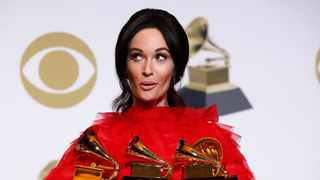 Kacey Musgraves poses backstage with her four awards, including for Album of the Year for 'Golden Hour'. Picture: Mario Anzuoni/Reuters