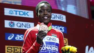 Kenya's Agnes Jebet Tirop poses with the bronze medal from the wold athletics championships. Picture: Ibraheem Al Omari/Reuters