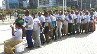 Khayelitsha residents queue in a symbolic line taking turns to sit on a toilet. Dozens of people traveled to the Civic centre to make their budget submissions. Picture Anel Lewis