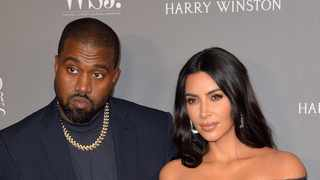 Kim Kardashian West and Kanye West are not calling off their divorce despite her appearance at his DONDA listening party. Picture: Bang Showbiz