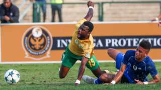 Knox Mutizwa of Golden Arrows feels the force of a Rushine De Reuck challenge. Picture: Leon Lestrade. African News Agency/ANA.
