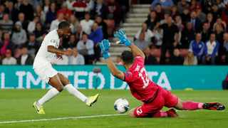 Kosovo's Aro Muric makes a save from England's Raheem Sterling on Tuesday. Photo: Reuters/Andrew Boyers