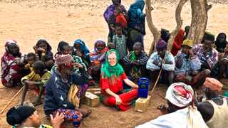 Kristine Pearson, with an interpreter, demonstrates how to use a Lifeplayer MP3, a solar and wind-up media player, radio and recorder, to a pastoral and semi-nomadic Gabra community in far northern Kenya. The Gabra travel with their livestock between Ethiopia and Kenya. They could receive short wave signals in remote areas, but not cellphone signals. Picture: Wario J Wario