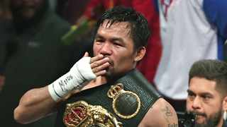 LAS VEGAS, NEVADA - JULY 20: Manny Pacquiao blows a kiss to the crowd as he celebrates his split-decision victory over Keith Thurman in their WBA welterweight title fight at MGM Grand Garden Arena on July 20, 2019 in Las Vegas, Nevada. Ethan Miller/Getty Images/AFP (Photo by Ethan Miller / GETTY IMAGES NORTH AMERICA / Getty Images via AFP)