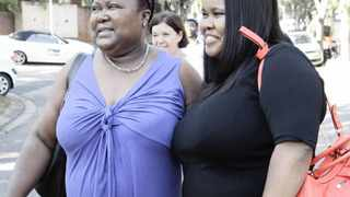 LINDIWE Mazibuko from the DA standing in a long line to cast her vote at Sunningdale Pre primary school she was going with her mom June Mazibuko Picture: Puri Devjee