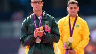 LONDON, ENGLAND - SEPTEMBER 03: (L-R) Silver medalist Oscar Pistorius of South Africa and gold medalist Alan Fonteles Cardoso Oliveira pose on the podium during the medal ceremony for the Men's 200m - T44 on day 5 of the London 2012 Paralympic Games at Olympic Stadium on September 3, 2012 in London, England. (Photo by Bryn Lennon/Getty Images)