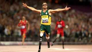 LONDON, ENGLAND - SEPTEMBER 08: Oscar Pistorius of South Africa celebrates as he wins gold in the Men's 400m T44 Final on day 10 of the London 2012 Paralympic Games at Olympic Stadium on September 8, 2012 in London, England. (Photo by Bryn Lennon/Getty Images)
