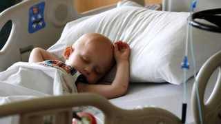 Landon Kimich, 2, sleeps as he receives a chemotherapy treatment for neuroblastoma at Houston's M.D. Anderson Cancer Center on Friday, May 22, 2015. The move to make cancer treatments gentler for children has paid a double dividend: more kids are surviving than ever before, and without the long-term complications that doomed many of their peers a generation ago, new research shows. AP Photo